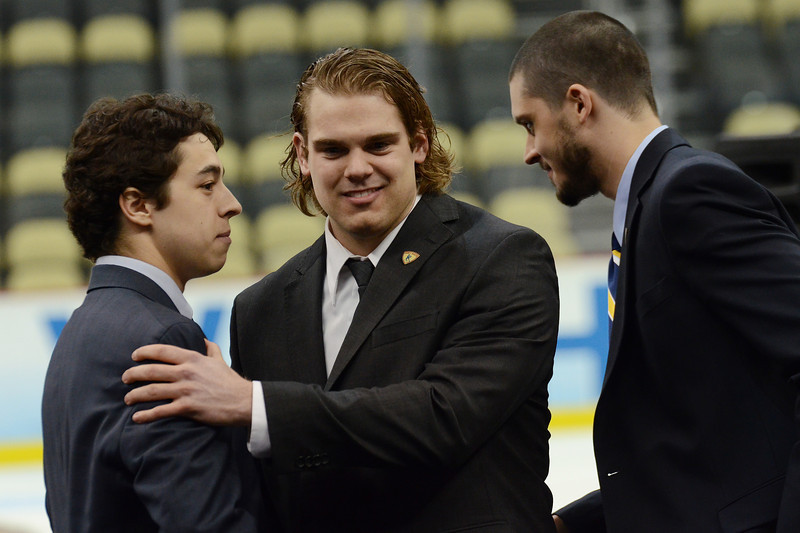 Drew LeBlanc is congratulated by the other Hobey Baker Award finalists.